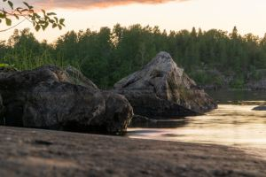Stones on the shore by Nikita Zakharkin